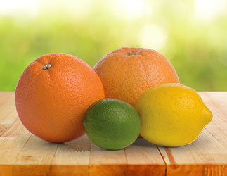 Orange, lemon and lime on a table